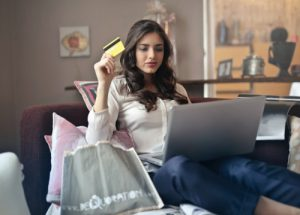 Credit and Buying Power - woman holding credit card