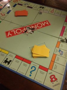 Mortgages - Monopoly board with mortgaged houses