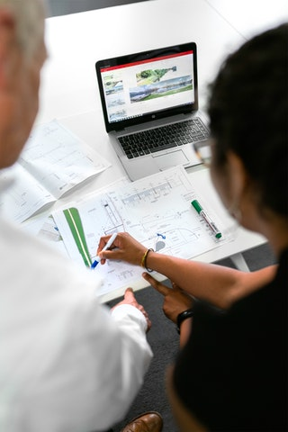 FHA Consultant and Home Owner looking at plans
