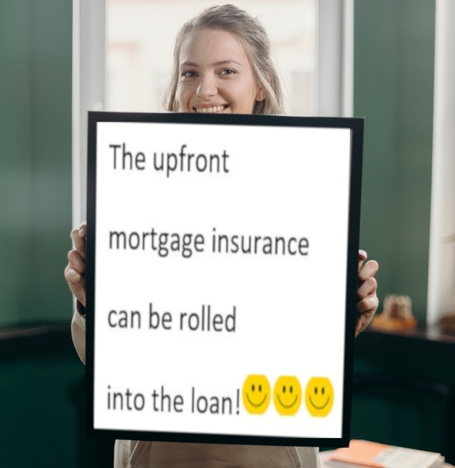 Woman holding a poster about HA Upfront Mortgage Insurance Premiums